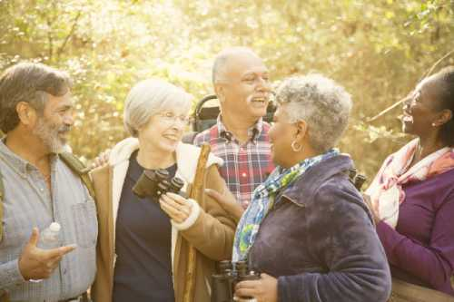 Mixed group of older people enjoying a day out hiking.